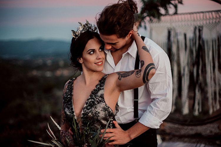 Bride in Antonia Serena Atelier Wedding Dress Embracing Groom in White Shirt and Braces