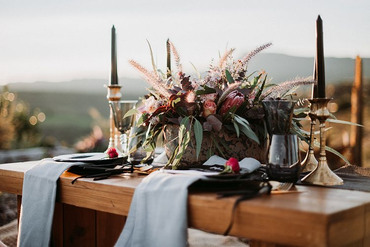 Sweetheart Table Decor with Gold Candle Sticks Black Taper Candles and Deep Red Floral Centrepiece