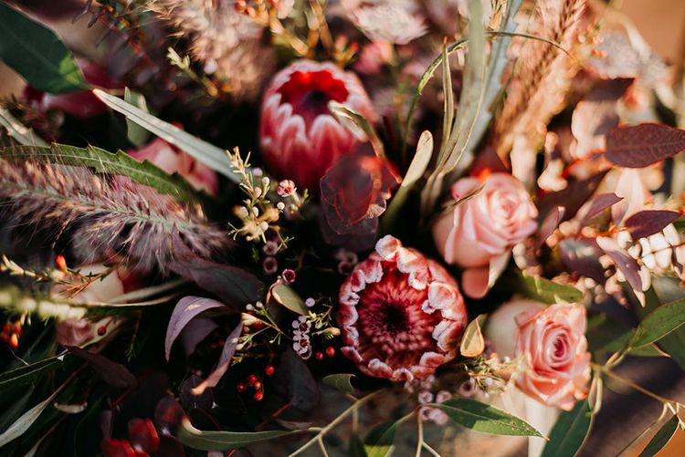 Deep Red and Green Wedding Flowers with Foliage, Roses and King Proteas