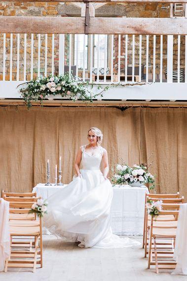 Bride at the Altar in Princess Wedding Dress | Blush Pink, Romantic, Country Wedding Inspiration at Tithe Barn, Dorset | Darima Frampton Photography