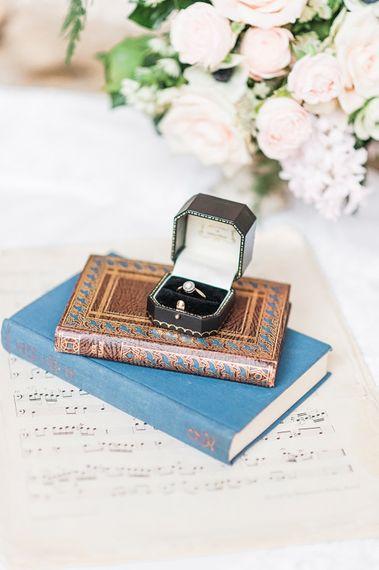 Wedding Ring on Vintage Books | Blush Pink, Romantic, Country Wedding Inspiration at Tithe Barn, Dorset | Darima Frampton Photography