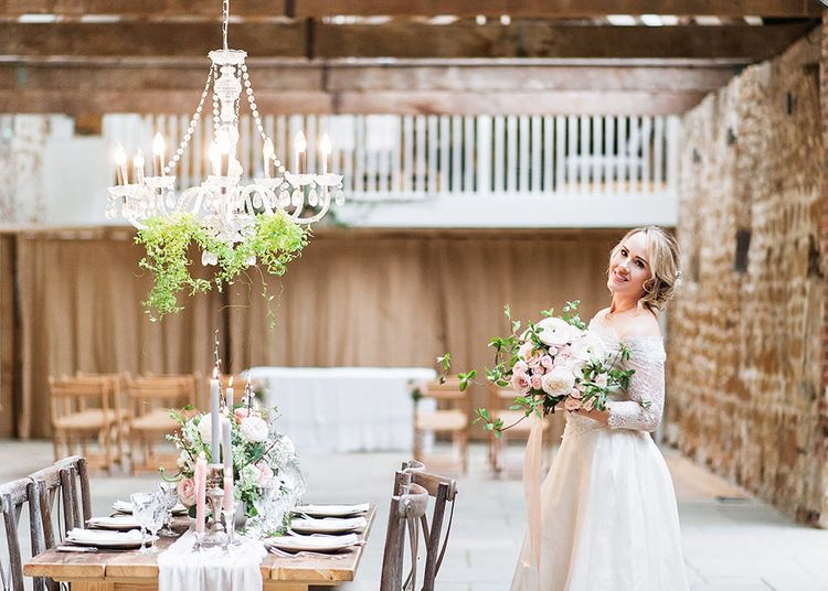 Bride in Lace, Bardot Bridal Gown | Reception Table with Hanging Chandelier | Blush Pink, Romantic, Country Wedding Inspiration at Tithe Barn, Dorset | Darima Frampton Photography