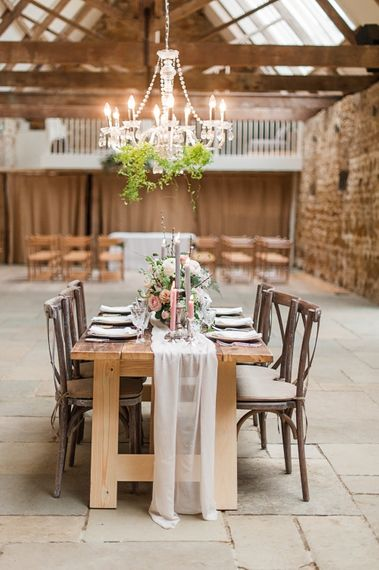 Elegant Tablescape with Taper Candles, Pink & White Roses,  Ranunculus & Anemone Floral Centrepiece & Hanging Chandelier | Blush Pink, Romantic, Country Wedding Inspiration at Tithe Barn, Dorset | Darima Frampton Photography