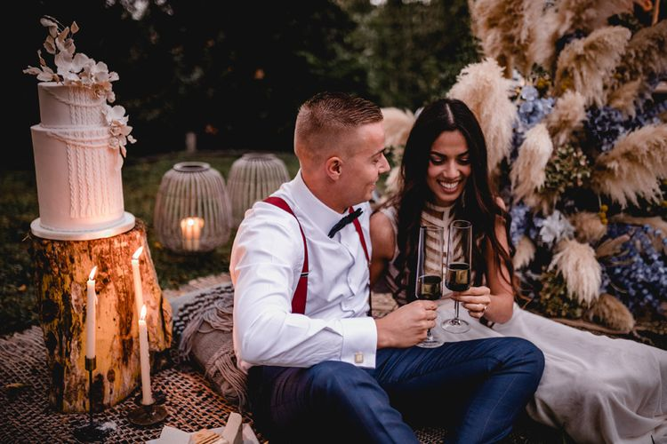 bride and groom toast their bohemian elopement