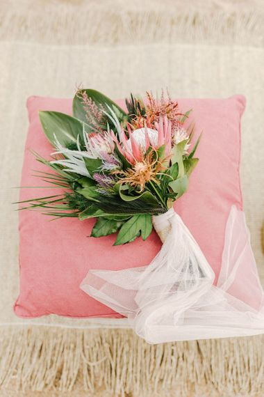Tropical Wedding Bouquet with Proteas and Palm Leaves