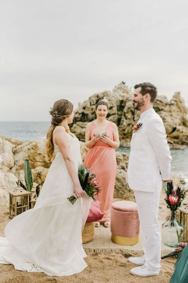 Bride and Groom Exchanging Vows at Their Beach Wedding Ceremony