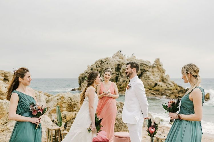 Tropical Green and Peach Beach Wedding Ceremony with Bride and Groom Laughing