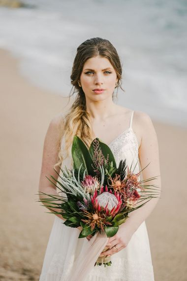 Bride with Natural Makeup Up Holding a Tropical Protea Wedding Bouquet