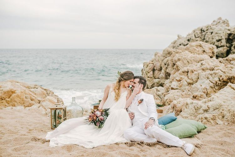 Portrait of Bride and Groom Sitting on the Sand