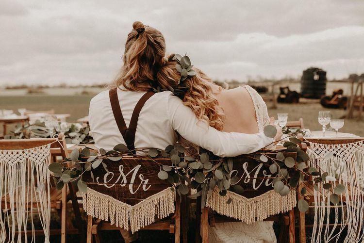 Wooden & Macrame Chair Back Decor | Two Bohemians Couple | Lucy Can't Dance Lace Bridal Gown | Boho at The Barns at Lodge Farm, Essex, by Rock The Day Styling | Kelsie Low Photography