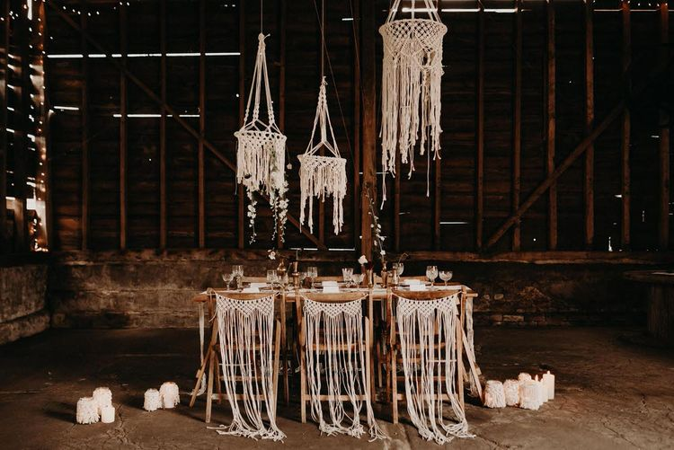 Macrame Chair Backs & Hangings | Table Scape | Goblets with Flower Stems  & Vintage Plate Wedding Decor | Boho at The Barns at Lodge Farm, Essex, by Rock The Day Styling | Kelsie Low Photography