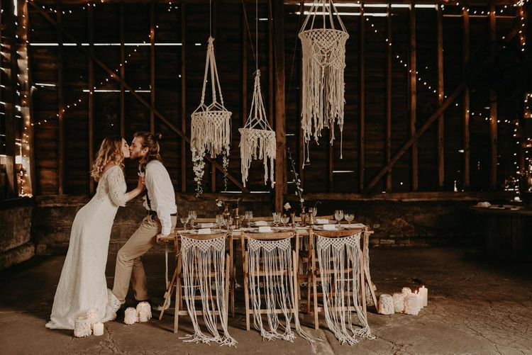 Macrame Chair Backs & Hangings | Table Scape | Goblets with Flower Stems  & Vintage Plate Wedding Decor | Two Bohemians Couple | Boho at The Barns at Lodge Farm, Essex, by Rock The Day Styling | Kelsie Low Photography