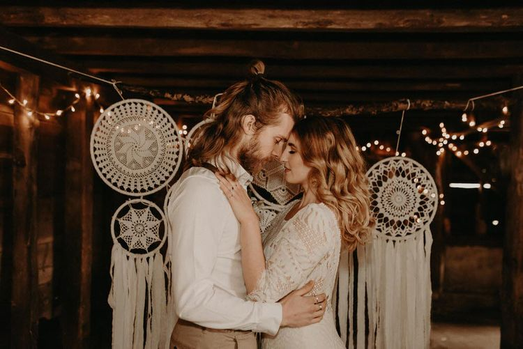 Two Bohemians Couple | Dream Catcher Wedding Decor | Lucy Can't Dance Lace Bridal Gown | Boho at The Barns at Lodge Farm, Essex, by Rock The Day Styling | Kelsie Low Photography
