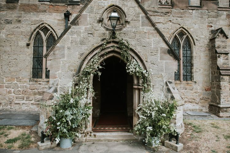 Floral Arch For Church Wedding Ceremony // Image By Rosie Kelly Photography