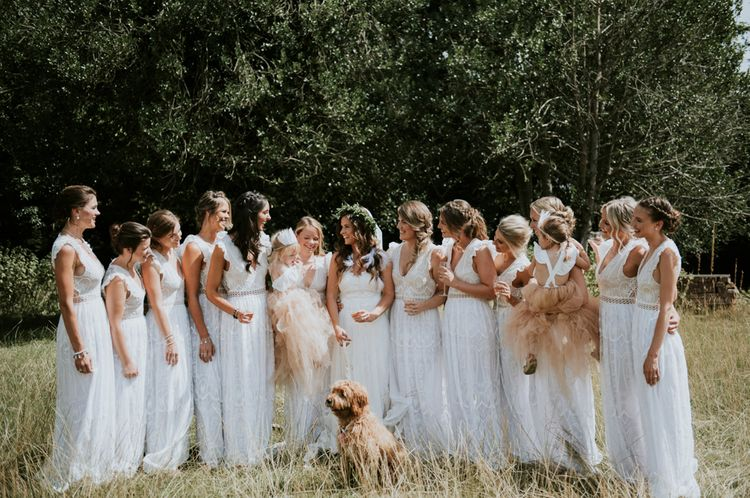Bridesmaids In White Dresses With Open Backs // Image By Rosie Kelly Photography