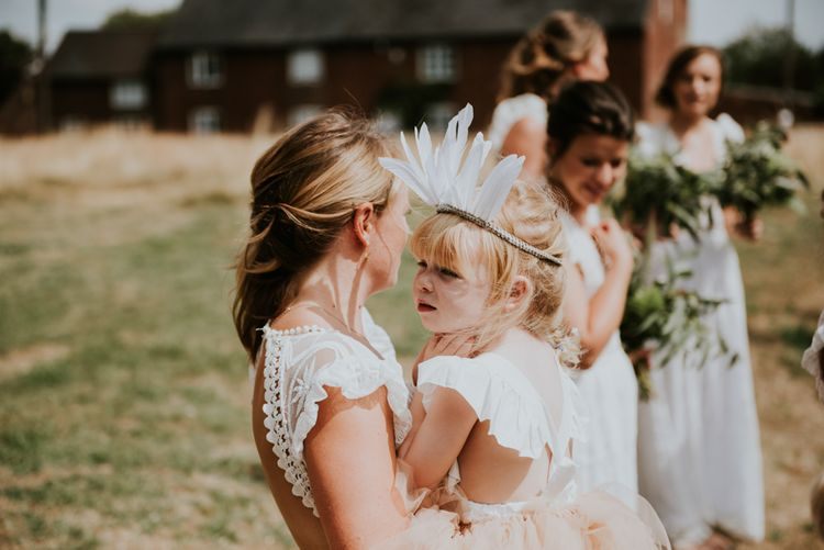 Flower Girl In White Feather Crown // Image By Rosie Kelly Photography