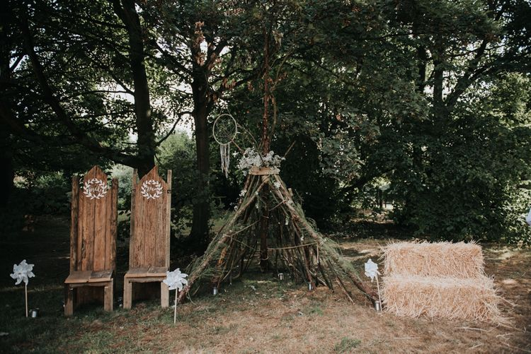 Outdoor Wedding Ceremony With Wooden Thrones For Couple // Image by Rosie Kelly Photography