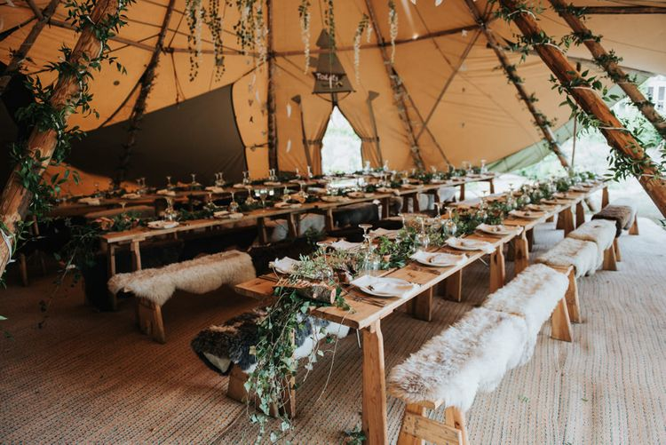 Foliage, Faux Fur And Feather Decor For A Boho Tipi Wedding // Image By Rosie Kelly Photography