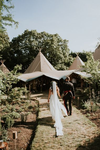 Boho Tipi Wedding With Bride In Hollie Dress By Grace Loves Lace And 12 Bridesmaids In White Dresses // Image by Rosie Kelly Photography