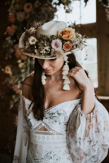 Fedora hat covered in dried flowers and tassel earrings. . Boho wedding dresses