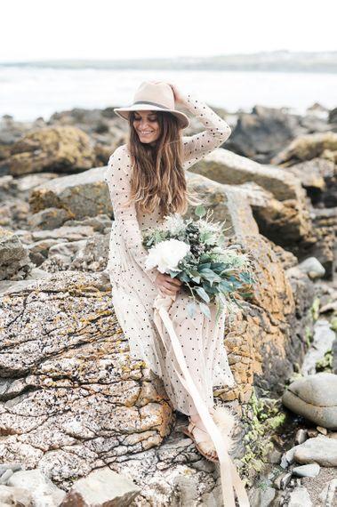 Bridal hat and flip flops for coastal wedding