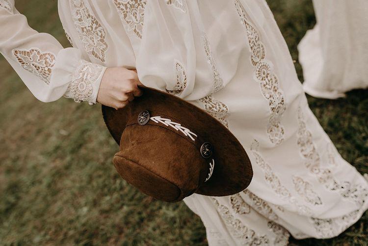 Felt bridal hat and boho wedding dress