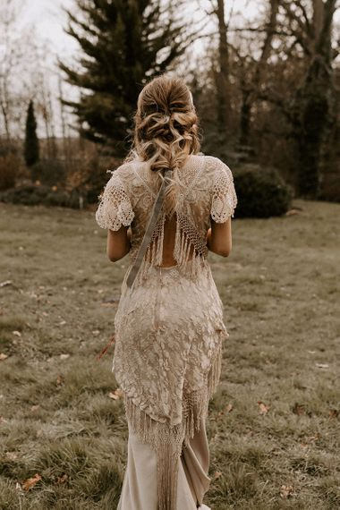 Lace boho wedding dress with fringe back detail