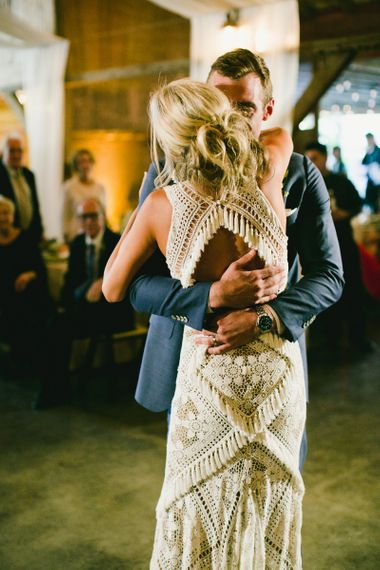 Lace wedding dress with fringe back detail