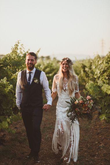 Handmade boho wedding dress with lace and fringe detail