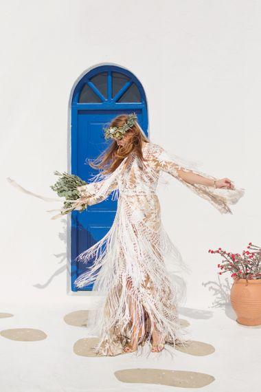 Bride in fringe boho wedding dress twirling