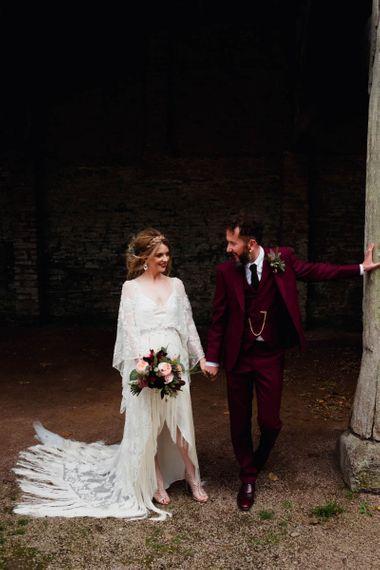Stylish bride in boho wedding dress with fringe detail