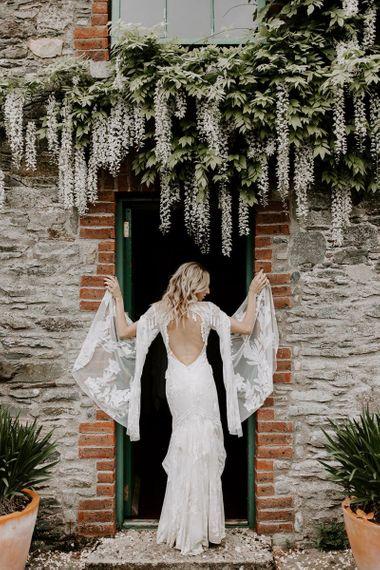 Low back a big sleeve boho wedding dress. . Boho wedding dresses