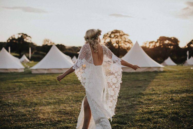 Boho bride in Grace Loves Lace wedding dress with sleeve detail. . Boho wedding dresses