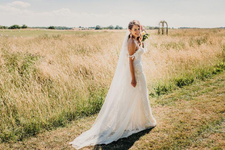 Lace wedding dress with Bardot sleeves