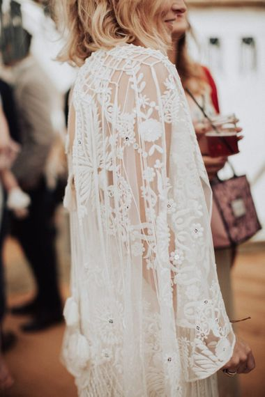 Applique lace detail on oversized sleeve
