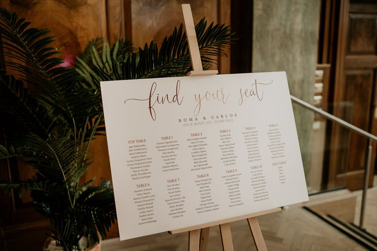 Find your seat table plan on wooden easel