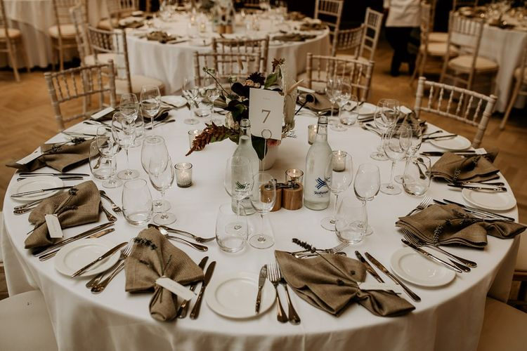 Round wedding reception tables with linen napkins