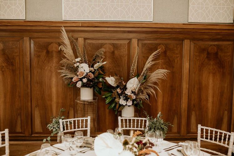 Wedding flower arrangements with pampas grass and white tropical Anthurium flower stems
