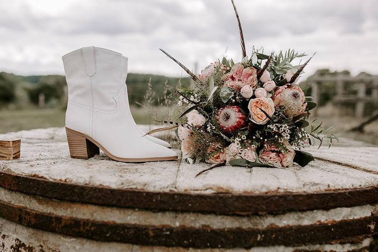 Protea bouquet with white bridal boots