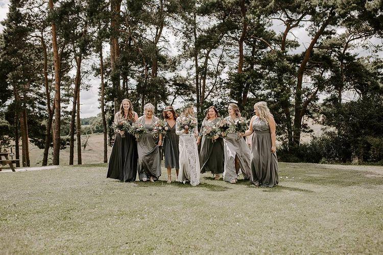 Grey bridesmaid dresses with Protea bouquet