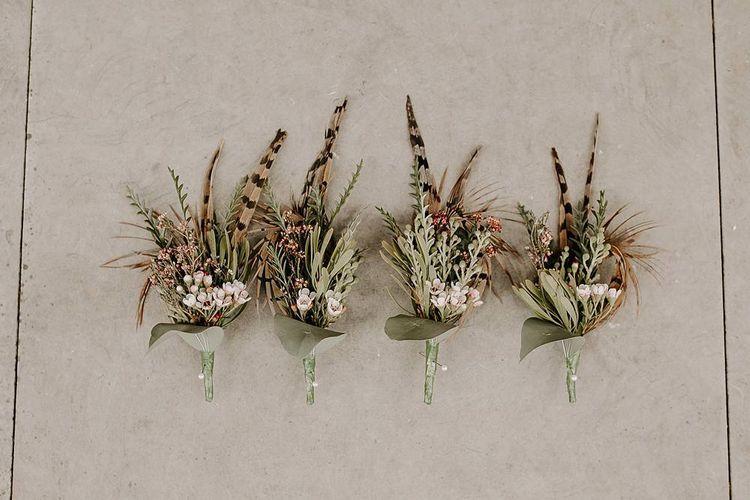 Wedding buttonholes to match Protea bouquet