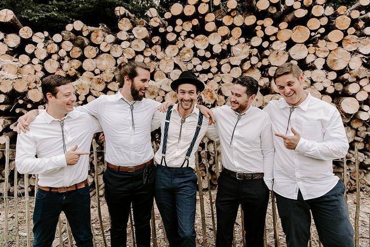 Groom and groomsmen in matching white shirts