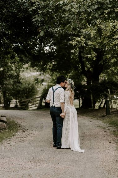 Bride in low back lace wedding dress with Protea bouquet