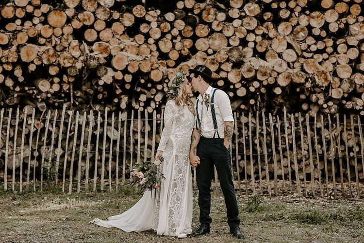 Bride clutches Protea bouquet as she kisses new husband