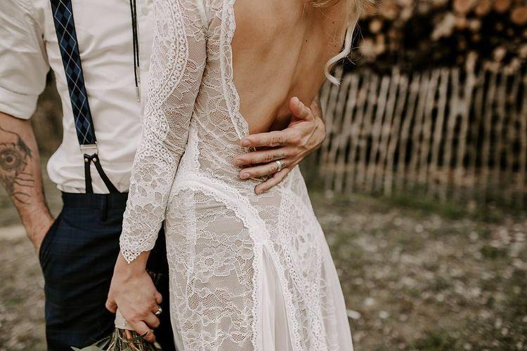 Low back lace detail wedding dress with Protea bouquet