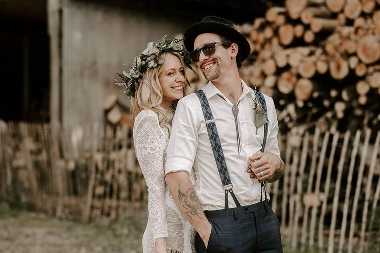 Bride and groom laugh as they pose for photos after the wedding ceremony