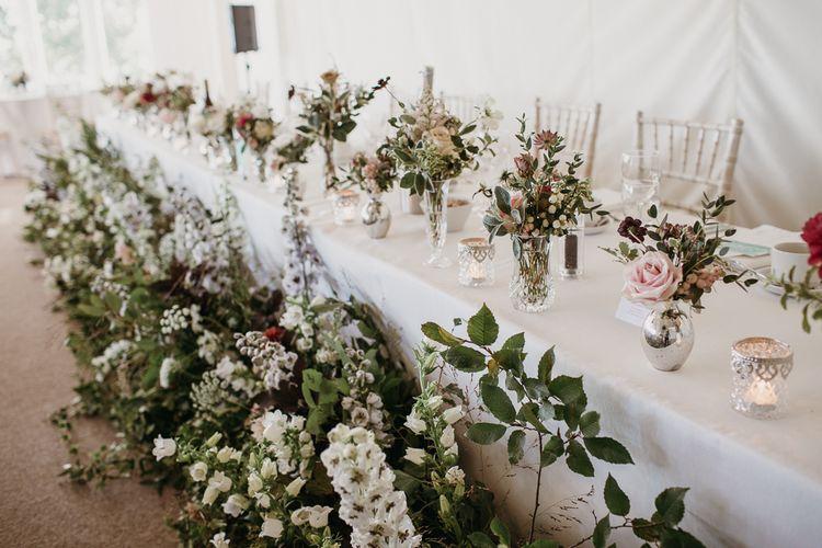 Top Table Wedding Flowers with Vases of Wildflowers and Floor Arrangements