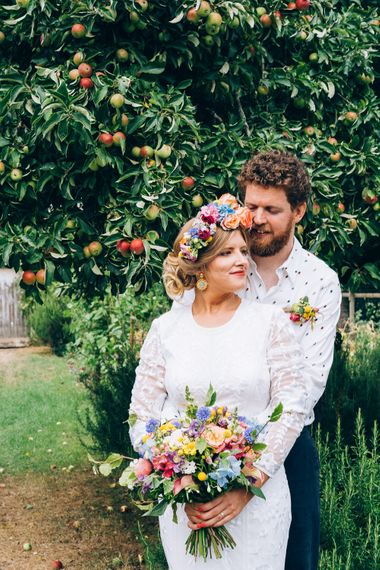 Bride In Brightly Colour Flower Crown // Image By Casey Avenue Photography