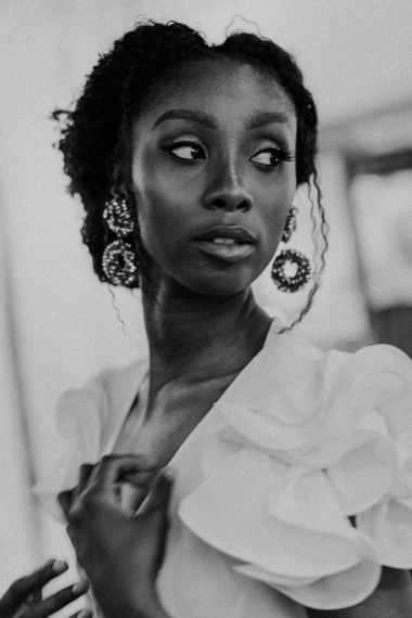 Beautiful Black Bride with Bridal Updo and Dangling Earrings
