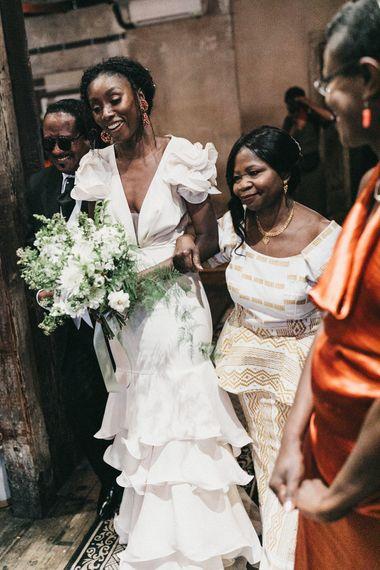 Wedding Ceremony Bridal Entrance in Ruffled Johanna Ortiz Wedding Dress Being Escorted Down The Aisle By Her Mum
